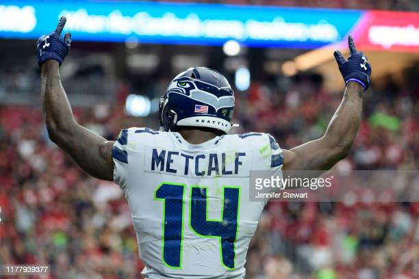 Wide receiver DK Metcalf of the Seattle Seahawks celebrates a touchdown that was scored in the second half of the NFL game against the Arizona...