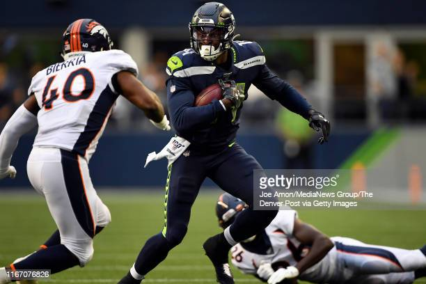 Wide receiver DK Metcalf of the Seattle Seahawks picks up extra yards as the Denver Broncos take on the Seattle Seahawks at CenturyLink Field August...