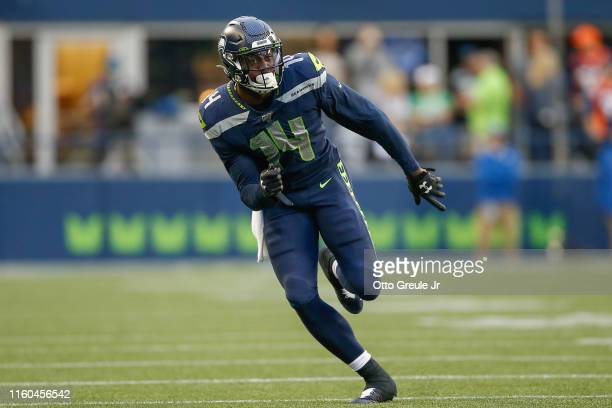 Wide receiver DK Metcalf of the Seattle Seahawks runs a pass route against the Denver Broncos at CenturyLink Field on August 8 2019 in Seattle...