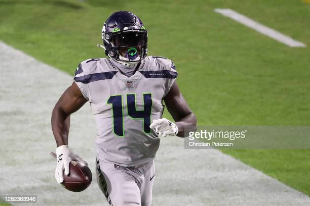 Wide receiver DK Metcalf of the Seattle Seahawks runs with the football after a reception against the Arizona Cardinals during the second 2half of...