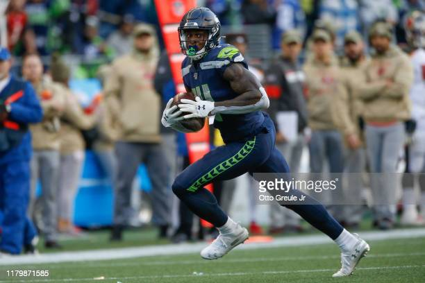 Wide receiver DK Metcalf of the Seattle Seahawks rushes for a touchdown in the second half against the Tampa Bay Buccaneers at CenturyLink Field on...