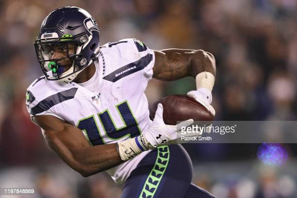 Wide receiver DK Metcalf of the Seattle Seahawks scores a touchdown against the Philadelphia Eagles during their NFC Wild Card Playoff game at...