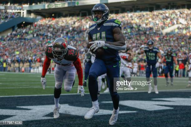 Wide receiver DK Metcalf of the Seattle Seahawks scores a twopoint conversion in the third quarter against the Tampa Bay Buccaneers at CenturyLink...