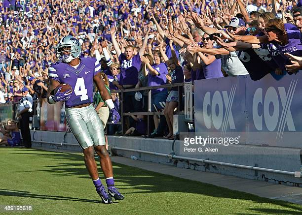 Wide receiver Dominique Heath of the Kansas State Wildcats looks on as Wildcat fans react after catching a touchdown pass against the Louisiana Tech...