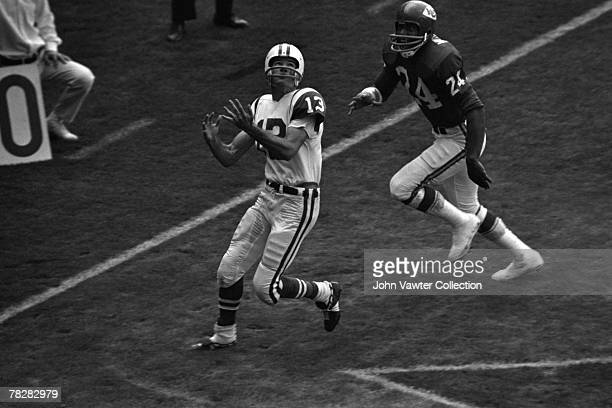 Wide receiver Don Maynard of the New York Jets catches a touchdown pass in front of defensive back Fred Williamson of the Kansas City Chiefs during...