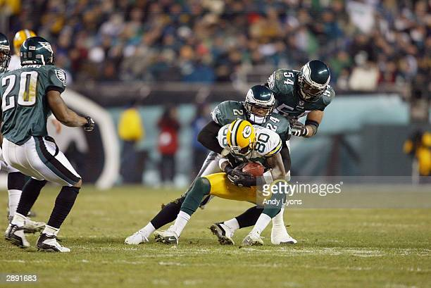 Wide receiver Donald Driver of the Green Bay Packers is tackled by Sheldon Brown of the Philadelphia Eagles during the NFC divisional playoffs on...