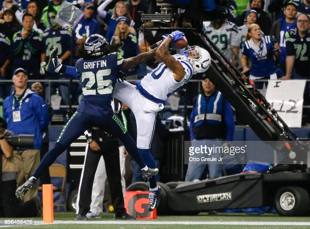 Wide receiver Donte Moncrief of the Indianapolis Colts pulls in an 18 yard touchdown against cornerback Shaquill Griffin of the Seattle Seahawks in...