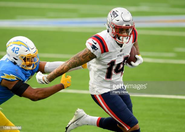 Wide receiver Donte Moncrief of the New England Patriots evades the tackle of linebacker Uchenna Nwosu of the Los Angeles Chargers for a first down...