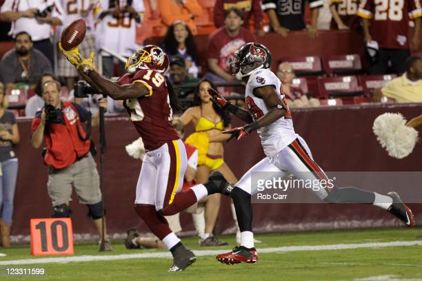 Wide receiver Donte' Stallworth of the Washington Redskins catches a pass for the game winning touchdown in front of DJ Johnson of the Tampa Bay...
