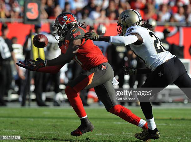 Wide receiver Donteea Dye of the Tampa Bay Buccaneers drops a pass as defensive back Brian Dixon of the New Orleans Saints defends in the fourth...