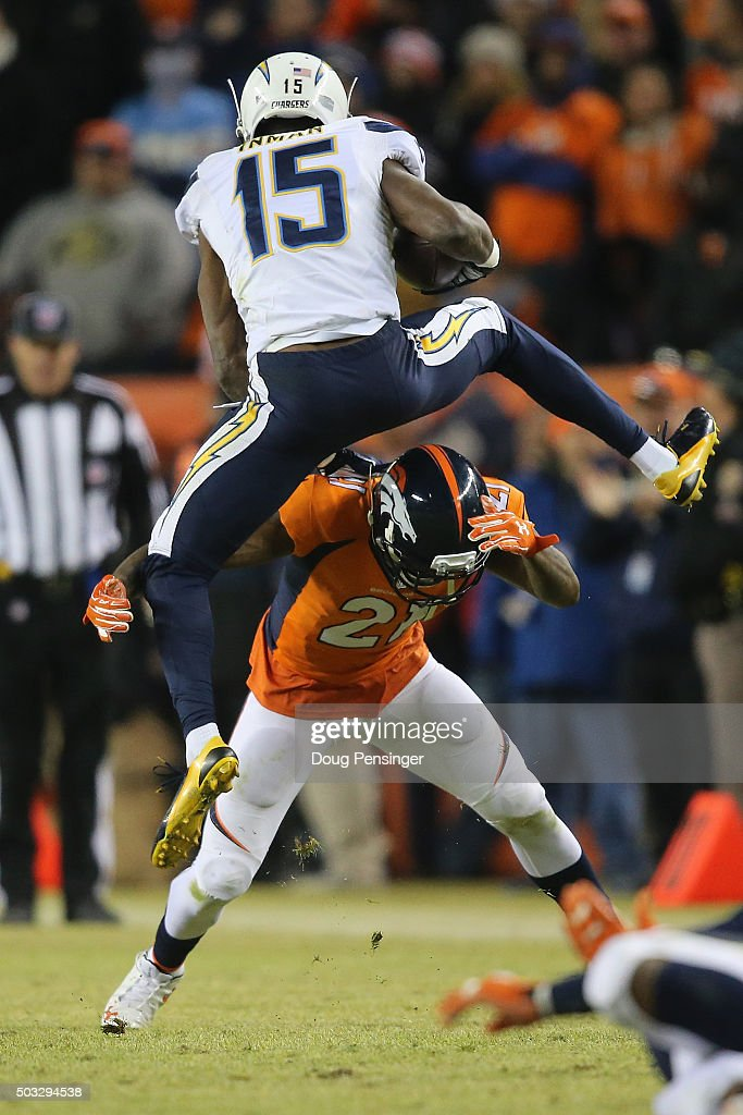 Wide receiver Dontrelle Inman #15 of the San Diego Chargers tries to hurdle Aqib Talib #21 of the Denver Broncos on a pass reception in the fourth quarter at Sports Authority Field at Mile High on January 3, 2016 in Denver, Colorado. The Broncos defeated the Chargers 27-20.