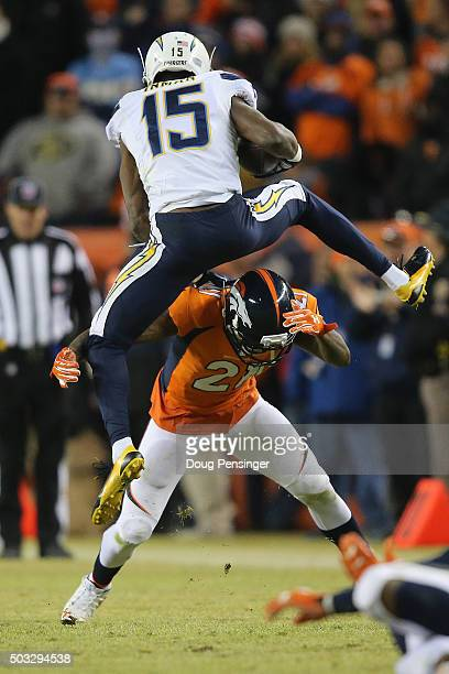 Wide receiver Dontrelle Inman of the San Diego Chargers tries to hurdle Aqib Talib of the Denver Broncos on a pass reception in the fourth quarter at...