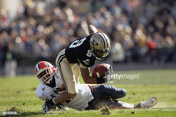 Wide receiver Dorien Bryant of the Purdue Boilermakers fights off a tackler against the Illinois Fighting Illini at RossAde Stadium on November 12...