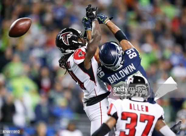 Wide receiver Doug Baldwin of the Seattle Seahawks can't bring in a pass against cornerback Desmond Trufant of the Atlanta Falcons during the fourth...