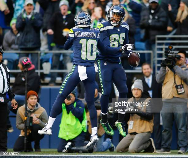 Wide receiver Doug Baldwin of the Seattle Seahawks celebrates his 18 yard touchdown with Paul Richardson during the third quarter of the game against...