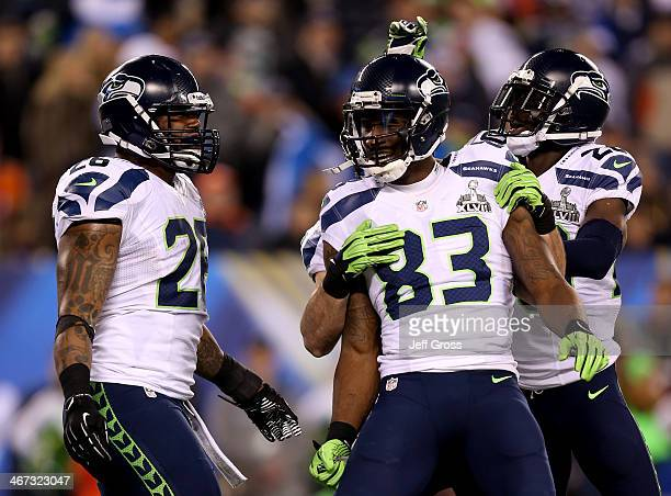 Wide receiver Doug Baldwin of the Seattle Seahawks celebrates his 10yard touchdown with Michael Robinson and Jeremy Lane in the fourth quarter...
