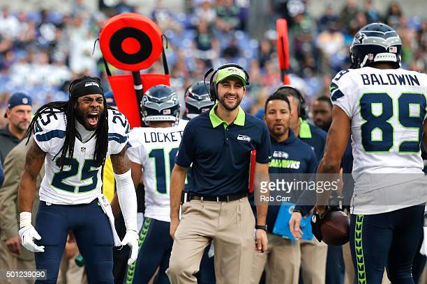 Wide receiver Doug Baldwin of the Seattle Seahawks celebrates with teammate cornerback Richard Sherman after scoring a fourth quarter touchdown...