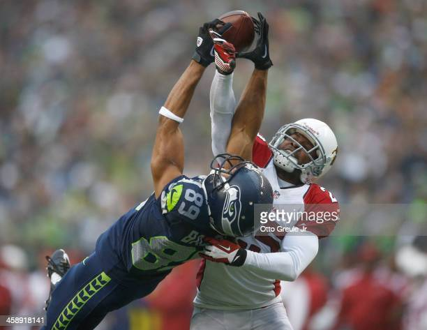 Wide receiver Doug Baldwin of the Seattle Seahawks has this pass broken up by cornerback Jerraud Powers of the Arizona Cardinals at CenturyLink Field...