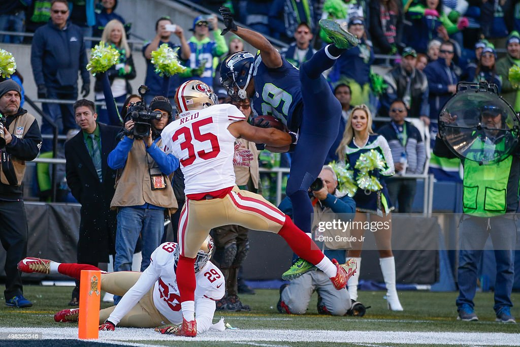 Wide receiver Doug Baldwin #89 of the Seattle Seahawks is knocked out of bounds just short of the goal line by Eric Reid #35 of the San Francisco 49ers at CenturyLink Field on November 22, 2015 in Seattle, Washington. The Seahawks defeated the 49ers 29-13.