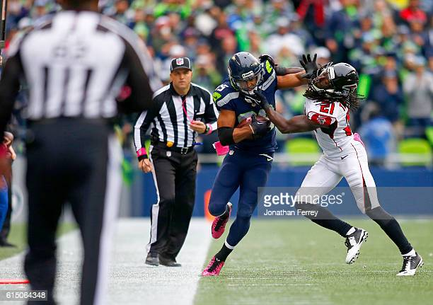 Wide receiver Doug Baldwin of the Seattle Seahawks is pushed out of bounds by cornerback Desmond Trufant of the Atlanta Falcons at CenturyLink Field...