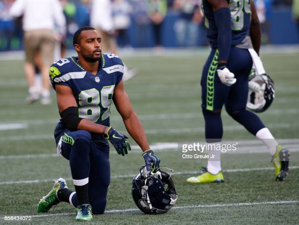 Wide receiver Doug Baldwin of the Seattle Seahawks kneels on the field before the game against the Indianapolis Colts at CenturyLink Field on October...