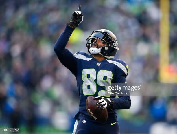 Wide receiver Doug Baldwin of the Seattle Seahawks points to the sky after scoring an 18 yard touchdown during the game against the Arizona Cardinals...