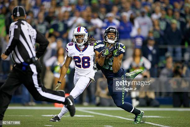 Wide receiver Doug Baldwin of the Seattle Seahawks pulls in a long reception against cornerback Ronald Darby of the Buffalo Bills at CenturyLink...