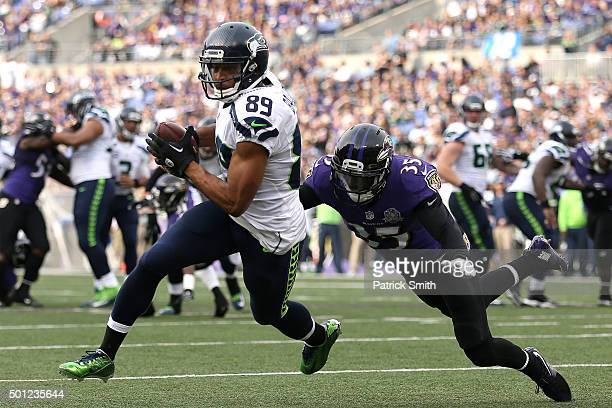 Wide receiver Doug Baldwin of the Seattle Seahawks runs to score a second quarter touchdown past defensive back Shareece Wright of the Baltimore...