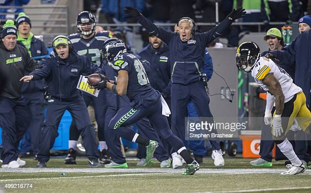 Wide receiver Doug Baldwin of the Seattle Seahawks runs to the end zone for an 80yard touchdown reception as he is chased by defensive back Antwon...