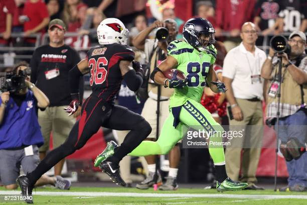 Wide receiver Doug Baldwin of the Seattle Seahawks runs with the football in front of safety Budda Baker of the Arizona Cardinals in the second half...