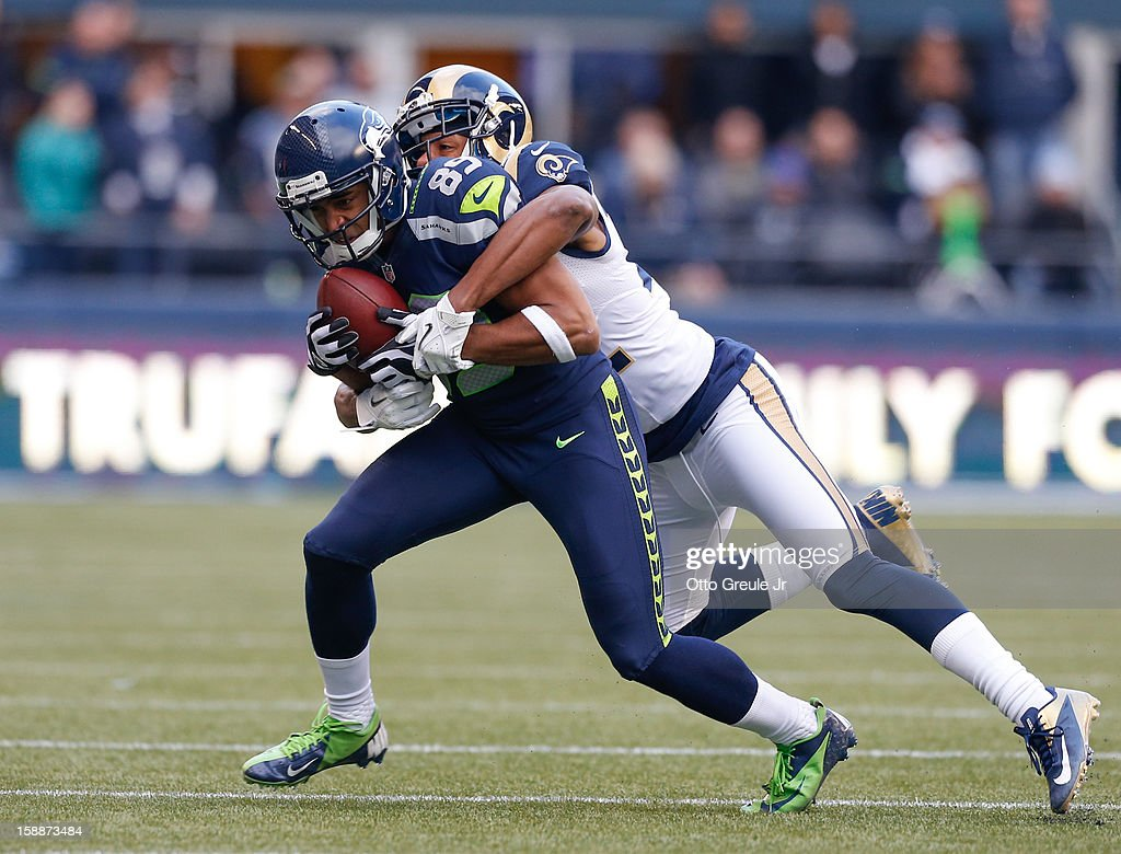 Wide receiver Doug Baldwin #89 of the Seattle Seahawks rushes against cornerback Trumaine Johnson #22 of the St. Louis Rams at CenturyLink Field on December 30, 2012 in Seattle, Washington.