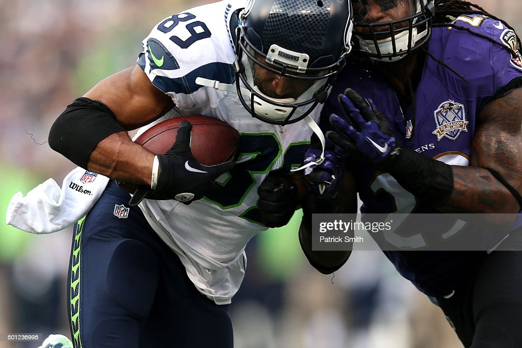 Wide receiver Doug Baldwin #89 of the Seattle Seahawks scores a third quarter touchdown past cornerback Jimmy Smith #22 of the Baltimore Ravens at M&T Bank Stadium on December 13, 2015 in Baltimore, Maryland.