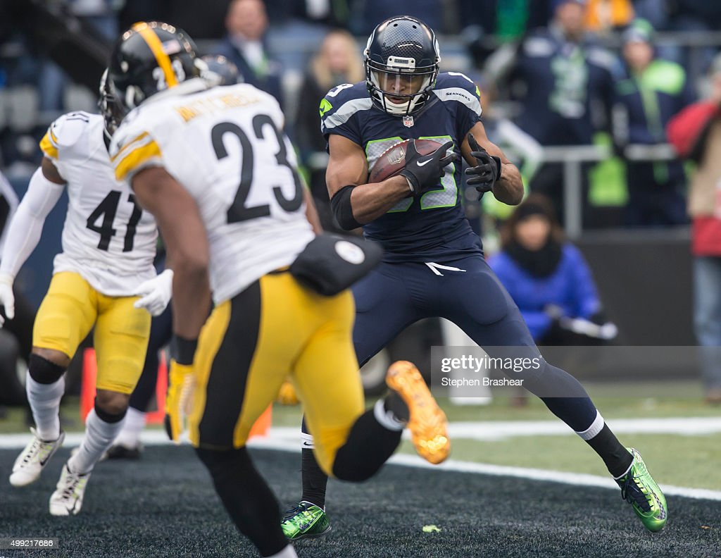 Wide receiver Doug Baldwin #89 of the Seattle Seahawks scores a touchdown during the first half of a football against the Pittsburgh Steelers at CenturyLink Field on November 29, 2015 in Seattle, Washington.