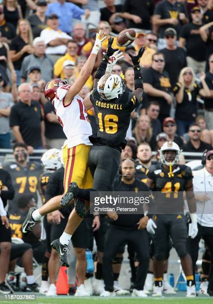 Wide receiver Drake London of the USC Trojans makes a reception over safety Aashari Crosswell of the Arizona State Sun Devils during the second half...