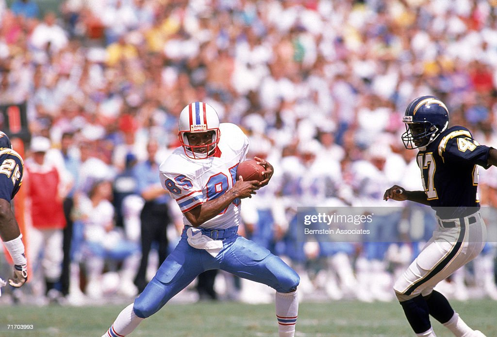 Wide Receiver Drew Hill #82 of the Houston Oilers battles to run the ball against the San Diego Chargers defensive line at Qualcomm Stadium on September 17, 1989. The Oilers won 34-27.