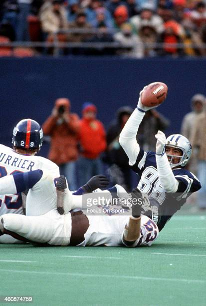 Wide Receiver Drew Pearson of the Dallas Cowboys gets tackled by Harry Carson of the New York Giants during an NFL Football game circa 1980 at The...