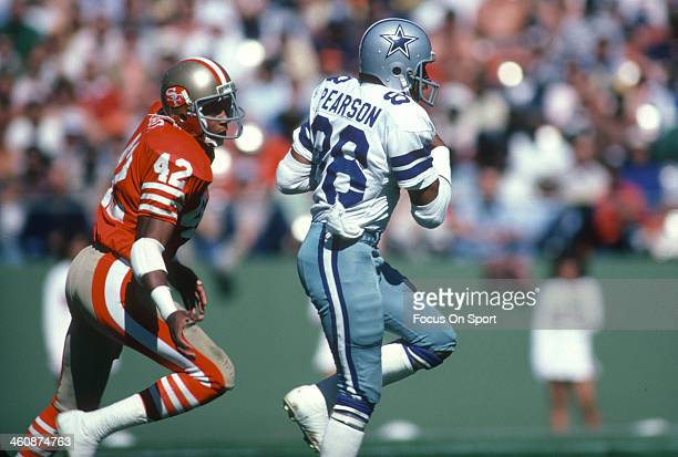 Wide Receiver Drew Pearson of the Dallas Cowboys runs with the ball pursued by Ronnie Lott of the San Francisco 49ers during an NFL football October...