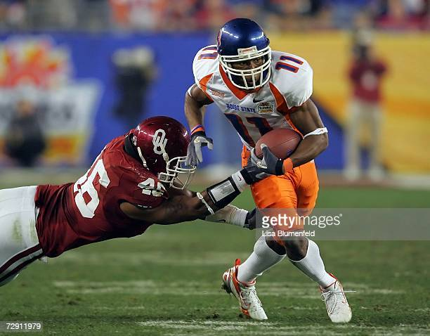 Wide receiver Drisan James of the Boise State Broncos breaks a tackle by linebacker Zach Latimer of the Oklahoma Sooners in the second quarter at the...
