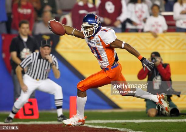 Wide receiver Drisan James of the Boise State Broncos scores a 49yard touchdown in the first quarter against the Oklahoma Sooners at the Tostito's...