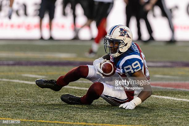 Wide receiver Duron Carter of the Montreal Alouettes falls to the ground with the ball during the CFL game against the Ottawa Redblacks at Percival...