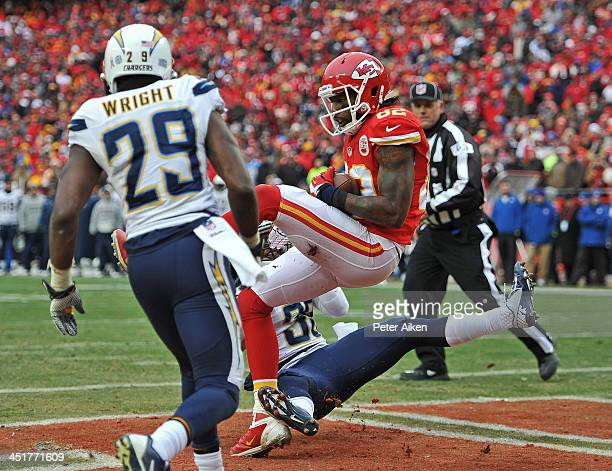 Wide receiver Dwayne Bowe of the Kansas City Chiefs catches a 5-yard touchdown pass against defensive back Shareece Wright of the San Diego Chargers...