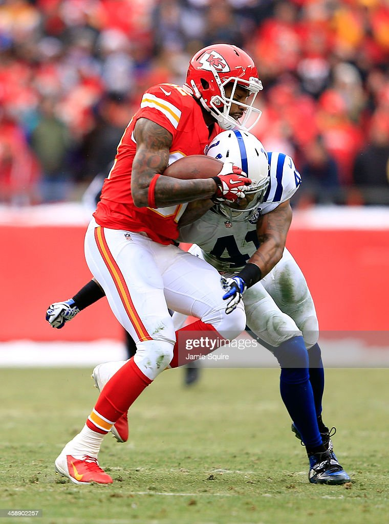 Wide receiver Dwayne Bowe #82 of the Kansas City Chiefs is hit by strong safety Antoine Bethea #41 of the Indianapolis Colts after making a catch during the game at Arrowhead Stadium on December 22, 2013 in Kansas City, Missouri.