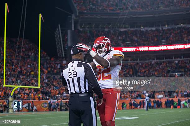 Wide receiver Dwayne Bowe of the Kansas City Chiefs taps the head of line judge Adrian Hill at Sports Authority Stadium on November 17 2013 in Denver...