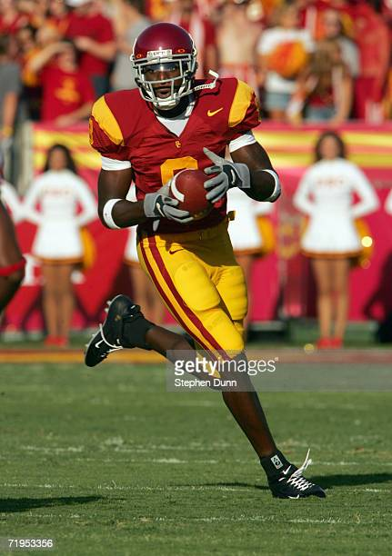 Wide receiver Dwayne Jarrett of the USC Trojans carries the ball against the Nebraska Cornhuskers on September 16 2006 at the Los Angeles Memorial...