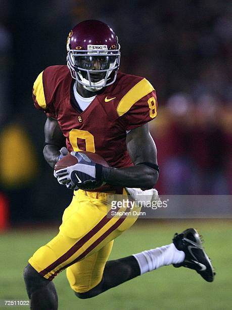 Wide receiver Dwayne Jarrett of the USC Trojans carries the ball against the Oregon Ducks on November 11, 2006 at the Los Angeles Memorial Coliseum...