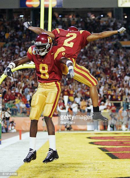 Wide receiver Dwayne Jarrett of the USC Trojans celebrates with teammate Steve Smith after scoring on a 54yard touchdown pass against the Oklahoma...