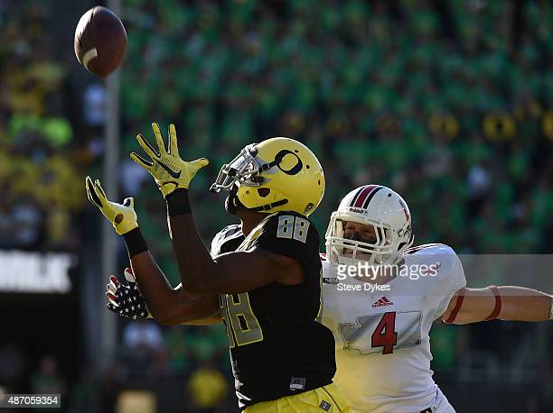 Wide receiver Dwayne Stanford of the Oregon Ducks catches a touchdown pass on defensive back Todd Raynes of the Eastern Washington Eagles during the...
