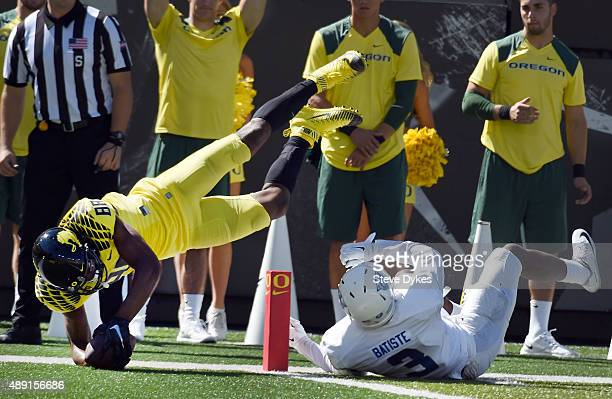 Wide receiver Dwayne Stanford of the Oregon Ducks dives over safety Tarris Batiste of the Georgia State Panthers for a touchdown during the second...