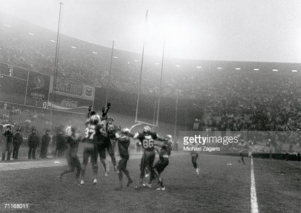 Wide receiver Dwight Clark of the San Francisco 49ers goes up for the pass in the endzone with other players on the last play of the game against the...