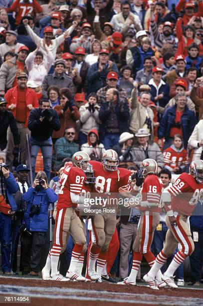 Wide receiver Dwight Clark tight end Russ Francis and quarterback Joe Montana of the San Francisco 49ers celebrate during the 1984 NFC Championship...